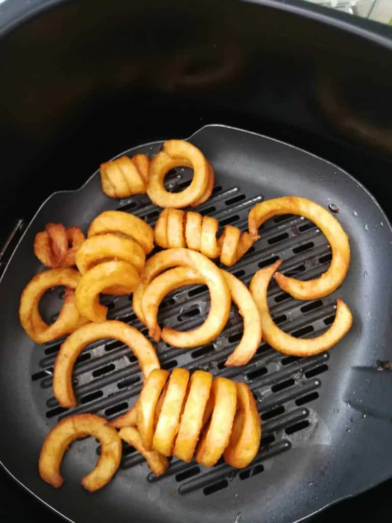 our first result from cooking frozen curly fries in our air fryer!